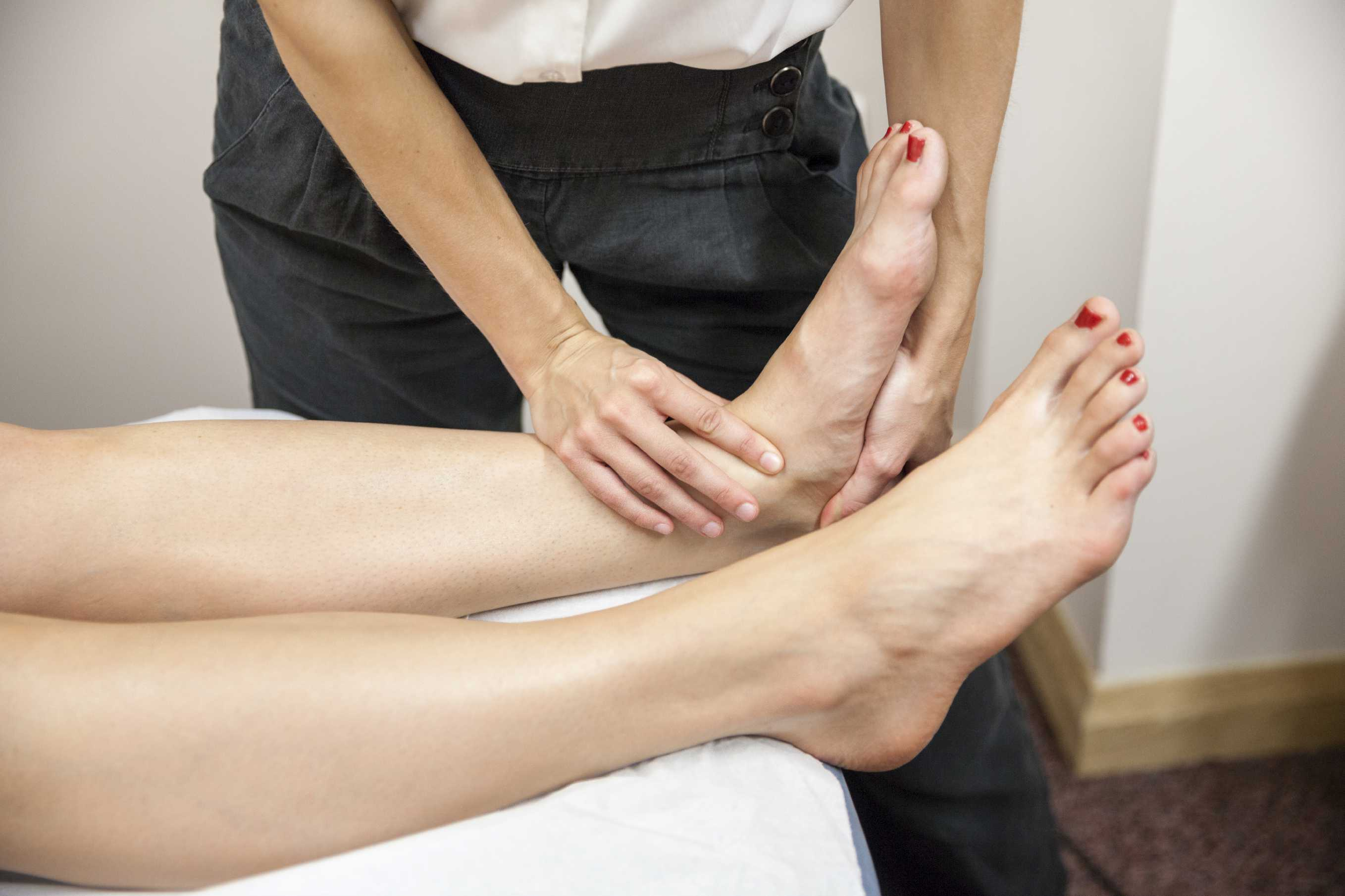 Woman having physio done on her ankle